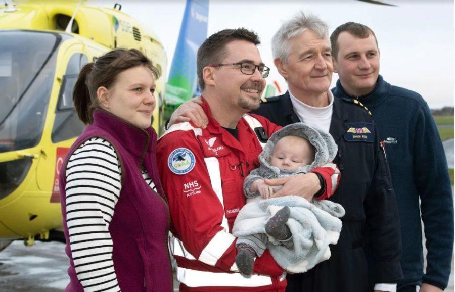 Reunited: Baby James with life saving crew.