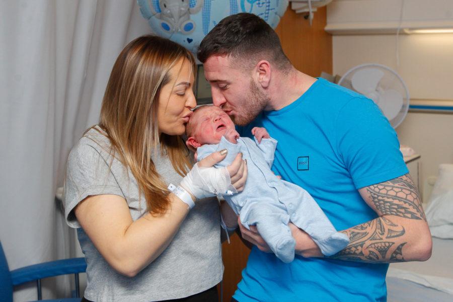 Happy New Year: Mum Emma Allan and dad Cameron Cunningham with their baby boy.