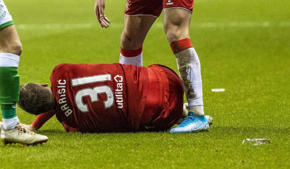 Football: A bottle was thrown while Borna Barisic lay on the ground.