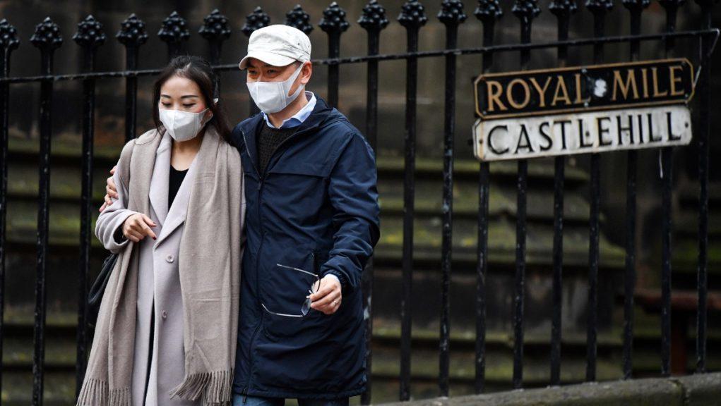 This man and woman were taking precautions in Edinburgh.