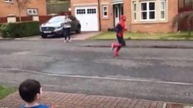 Spiderman runs around Dunfermline to raise money for his son's school.
