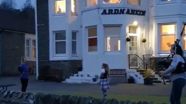 Highland dancers perform outside care home.