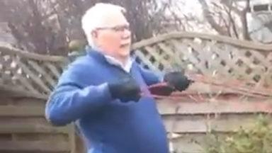 Pensioner works out in his garden during coronavirus outbreak