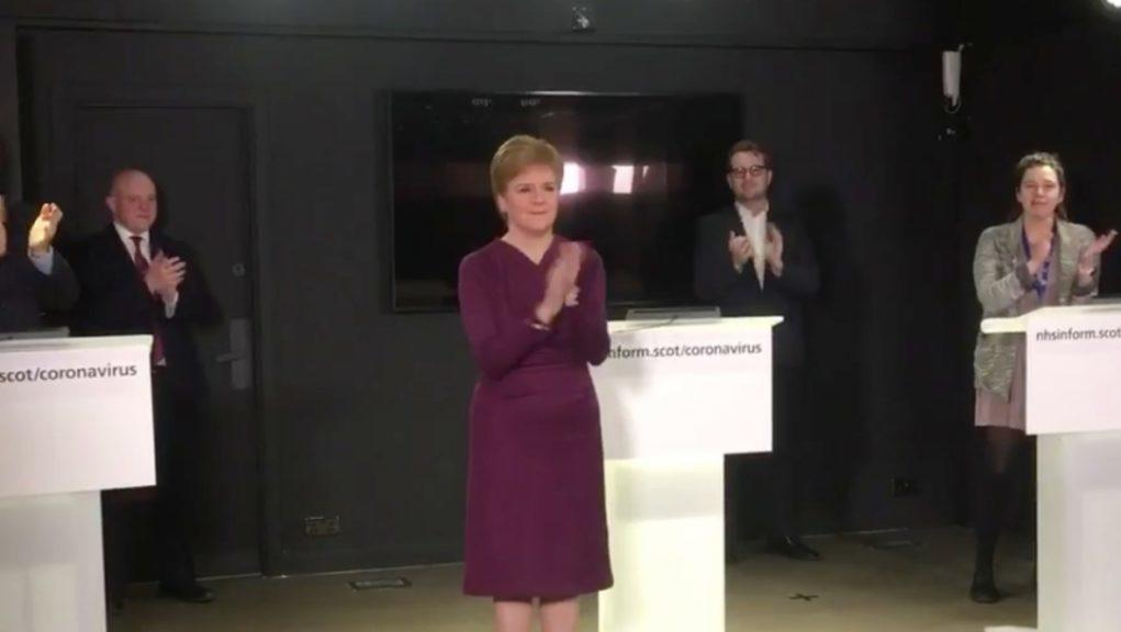Applause: First Minister claps for NHS staff.