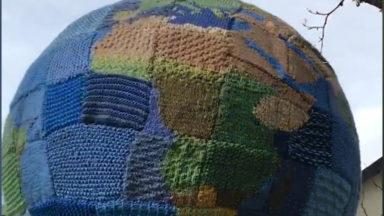 Group of knitters make a globe during lockdown.