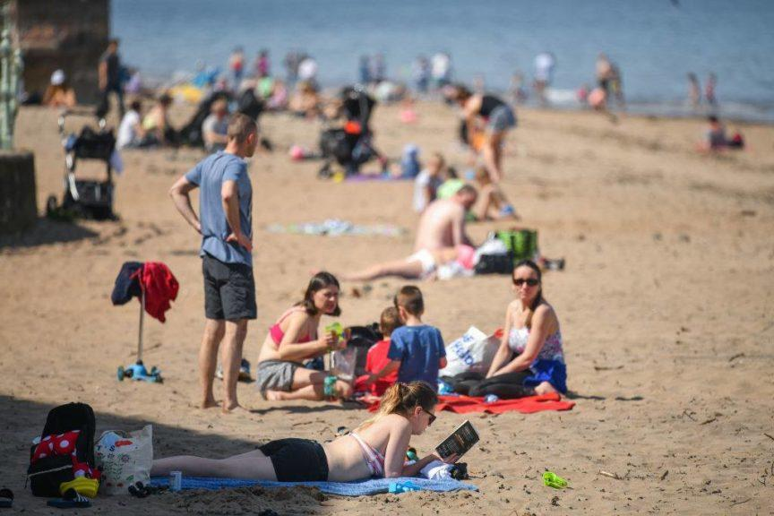 Sunseekers: A number of people were seen relaxing on the beach.