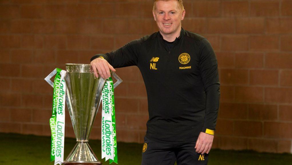 Title win: Celtic boss Neil Lennon with the trophy.