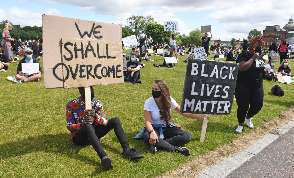 Anti-racism protesters gather at Black Lives Matter ...