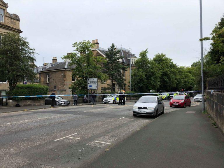 Disturbance: Officer struck by car.