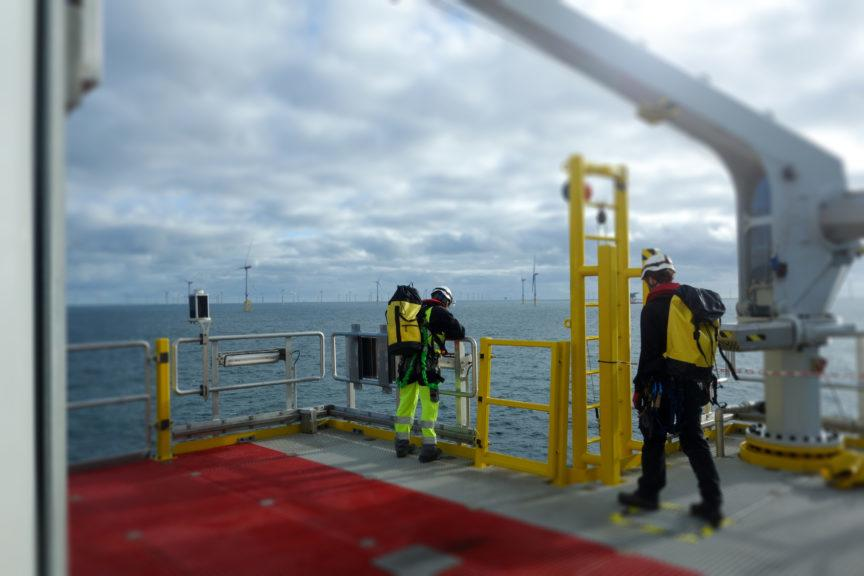 Offshore energy: Workers at a wind turbine.