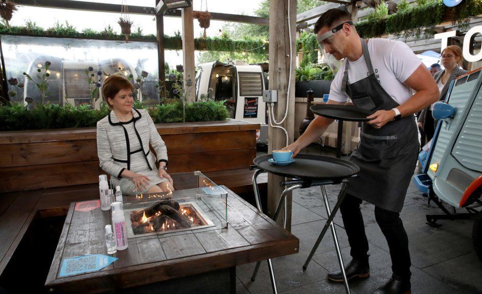 Nicola Sturgeon served a coffee outdoors at an Edinburgh cafe.