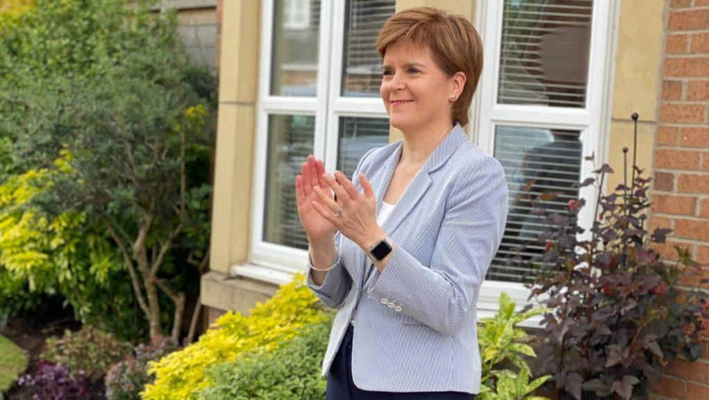 First Minister applauding NHS workers.