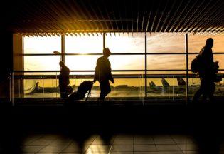 Man traveling through airport.