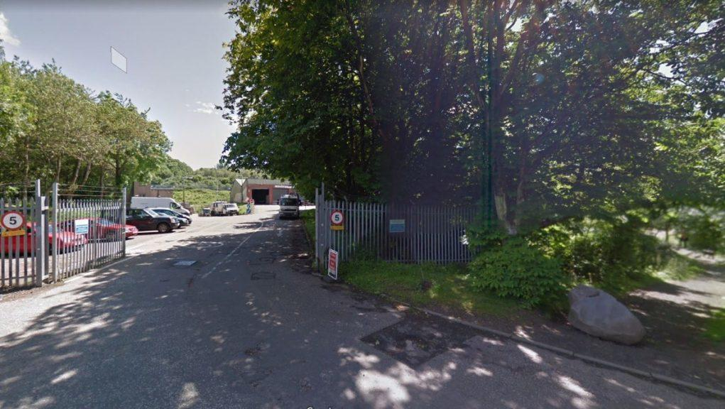 Waste Recyling Centre closed after man's body found nearby.
