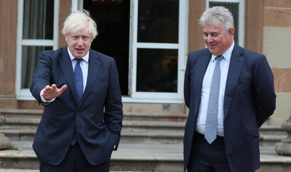 Northern Ireland: Boris Johnson and Brandon Lewis (right) during visit in August.