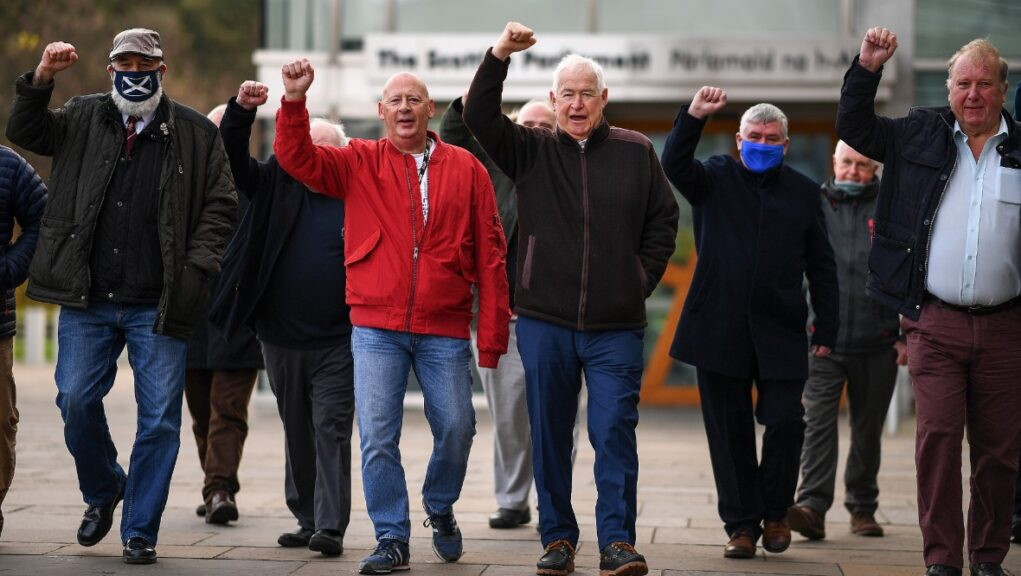 Former miners were at the Scottish Parliament as the pardoning announcement was made.