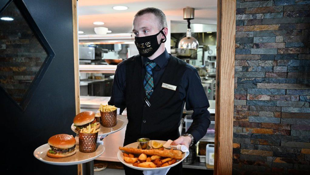 Economy: UK Government encouraged people back into normality with Eat Out to Help Out scheme.