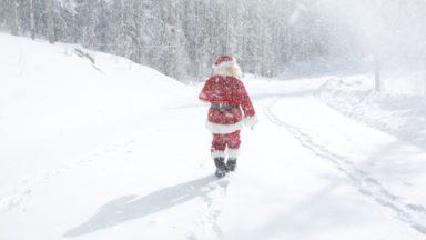 Santa Claus on a snowy roadway.