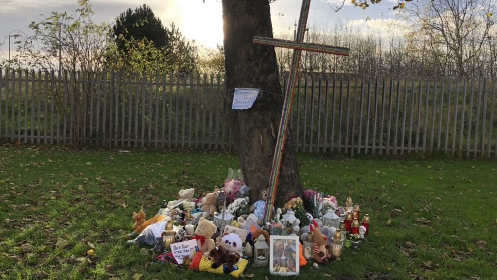 Tributes have been left near the home in Edinburgh where the boy was found.