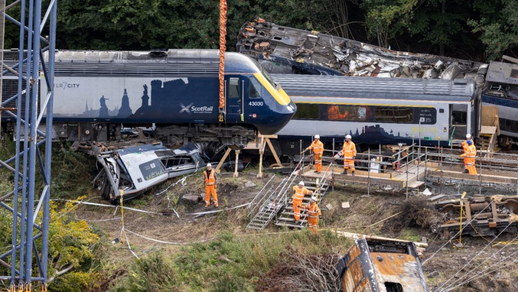 Train carriage being removed from scene of derailment.