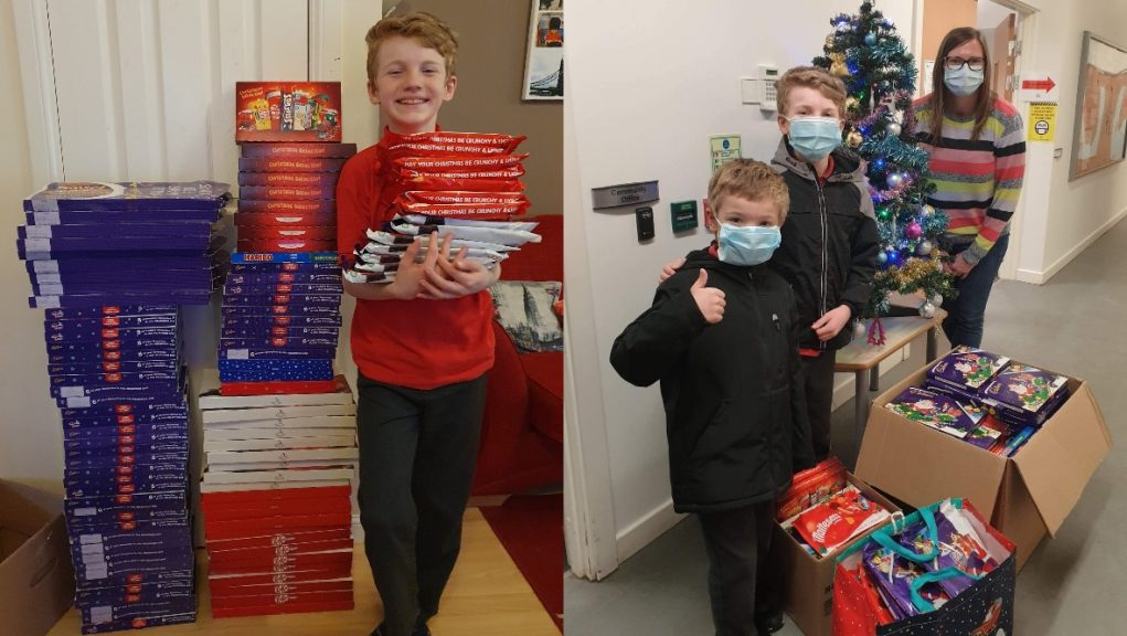 Feeling festive: Logan Taylor has collected 150 selection boxes to give to those in need.