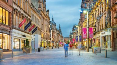 Buchanan Street shopping district in downtown Glasgow Scotland UK - stock photo Stock photograph of people walking on Buchanan Street in downtown Glasgow, Scotland, UK at twilight. Buchanan Street forms the central stretch of Glasgow's famous shopping district.