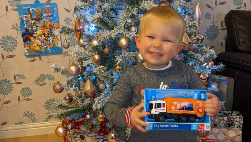 Festive cheer: Two-year-old Ollie given special Christmas gift.