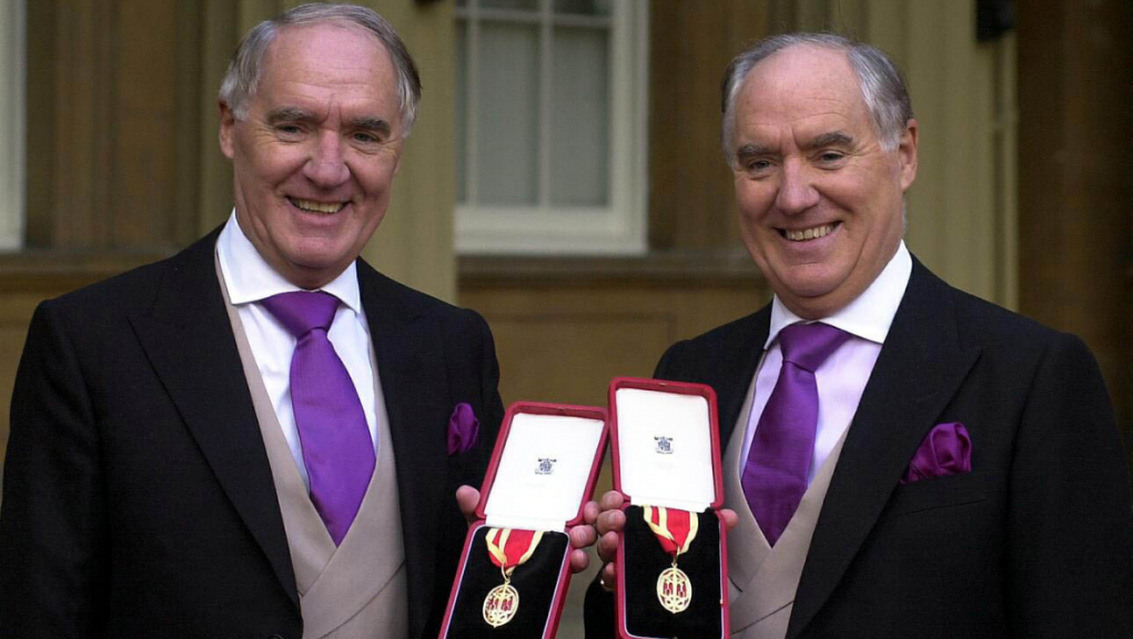 Sir David Barclay (left) and his twin brother Sir Frederick after receiving their knighthoods from the Queen in 2000.
