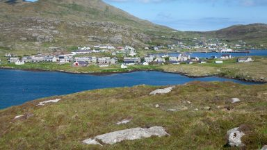 Castlebay is the main village on the island of Barra in the Outer Hebrides, Scotland. The village is located on the south coast of the island, and overlooks a bay in the Atlantic Ocean dominated by Kisimul Castle