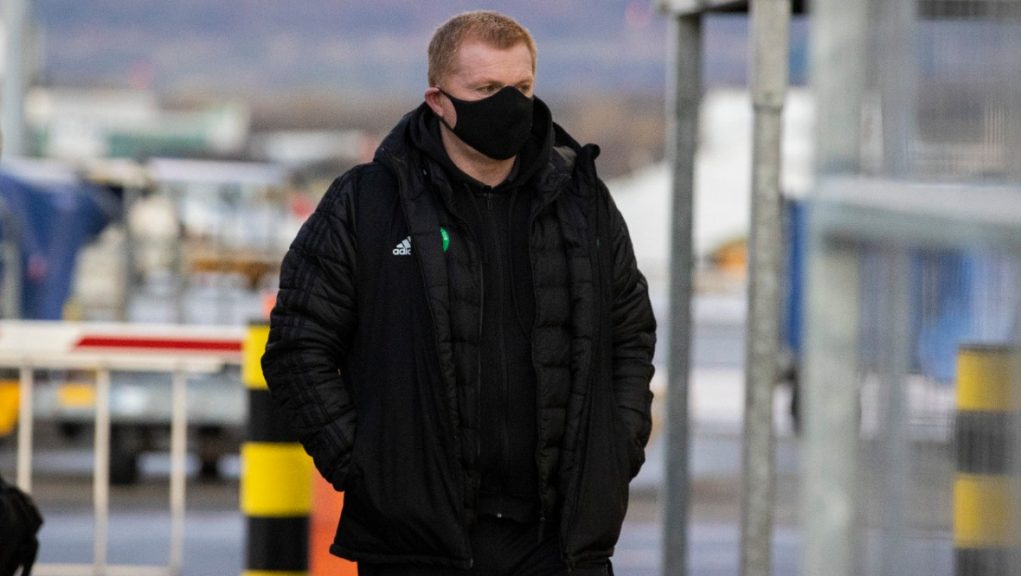 Neil Lennon arriving at Glasgow airport for flight to Dubai.