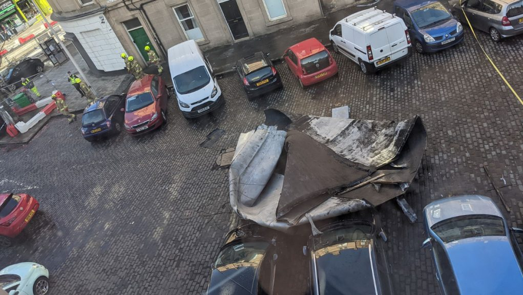 At around 12.45pm, the roof was blown into Iona Street and collided with several cars.