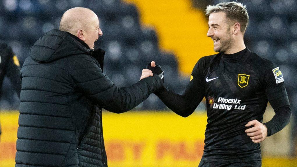Martindale and Robinson celebrate victory at Kilmarnock.