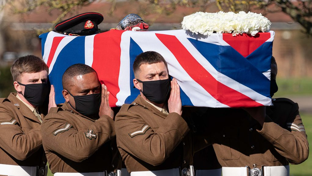 Members of the armed forces carrying Captain Sir Tom Moore's coffin.