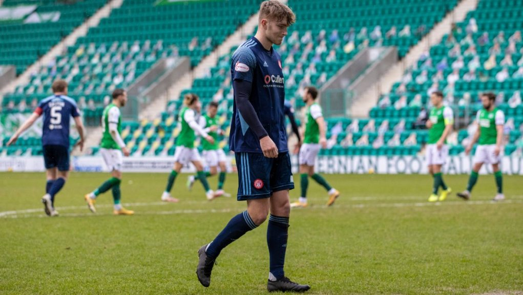 Jamie Hamilton leaves the Easter Road pitch after being sent off.