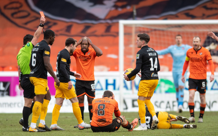 Referee Nick Walsh sends off Peter Pawlett of Dundee United during a Scottish Premiership match between Dundee United and Livingston at Tannadice Park, on February 13, 2021.