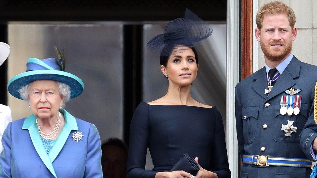 The Queen and the Duke of Duchess of Sussex on the balcony of Buckingham Palace.