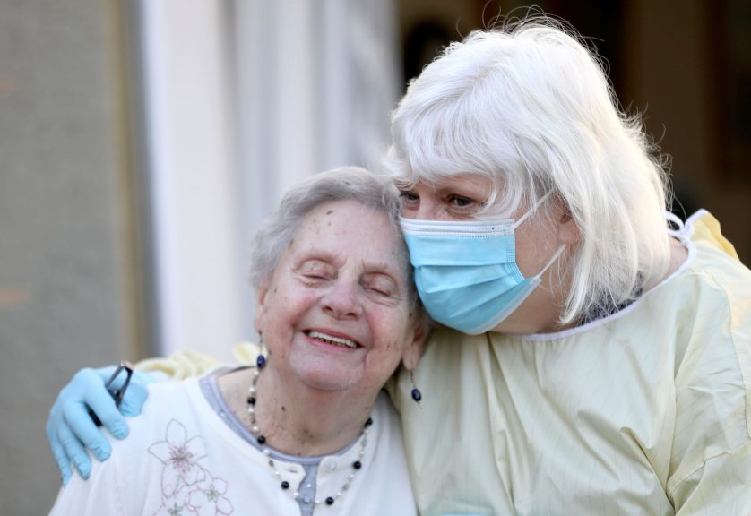 Mary Cook (left), 90, receives her first visit in three months from her daughter at Queen's House in Kelso.