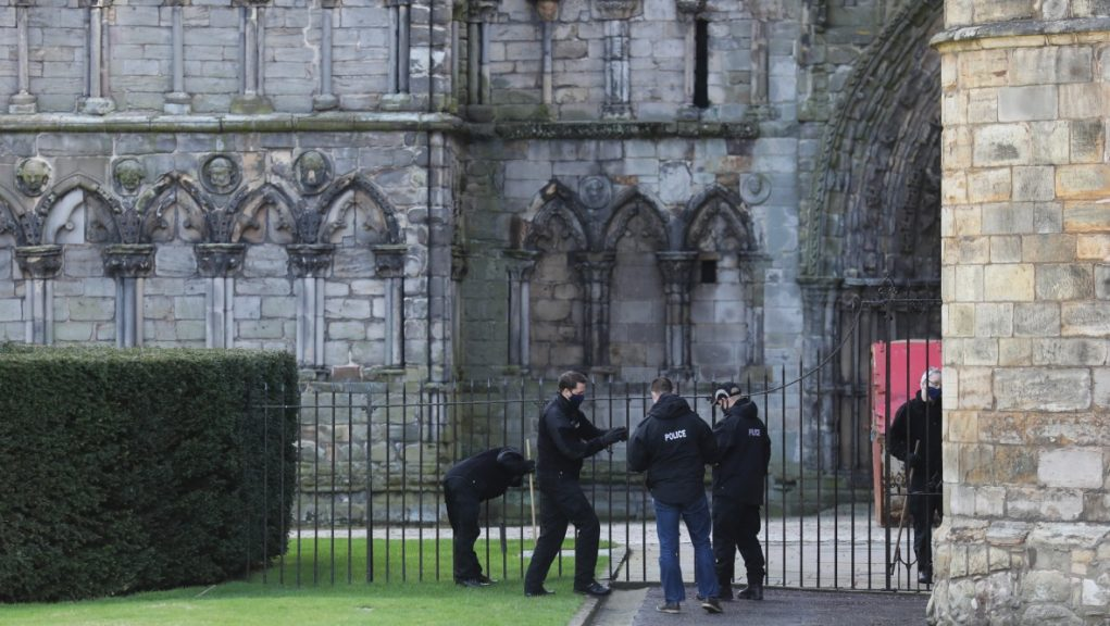 Police were pictured searching the grounds at the Palace of Holyroodhouse.