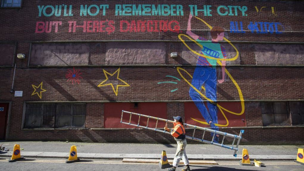 The mural features Shuggie dancing in the street and a quote from the book.