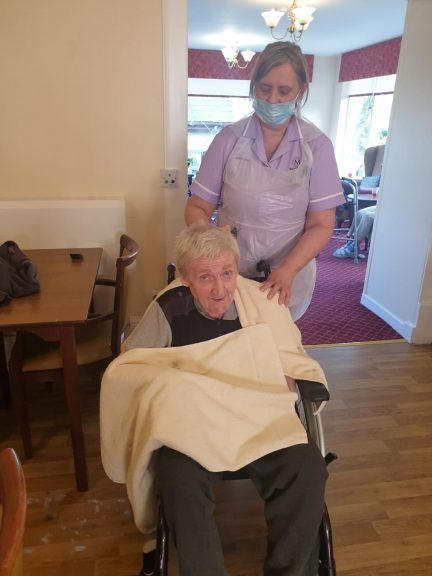 Lucky: Care home residents get haircuts.