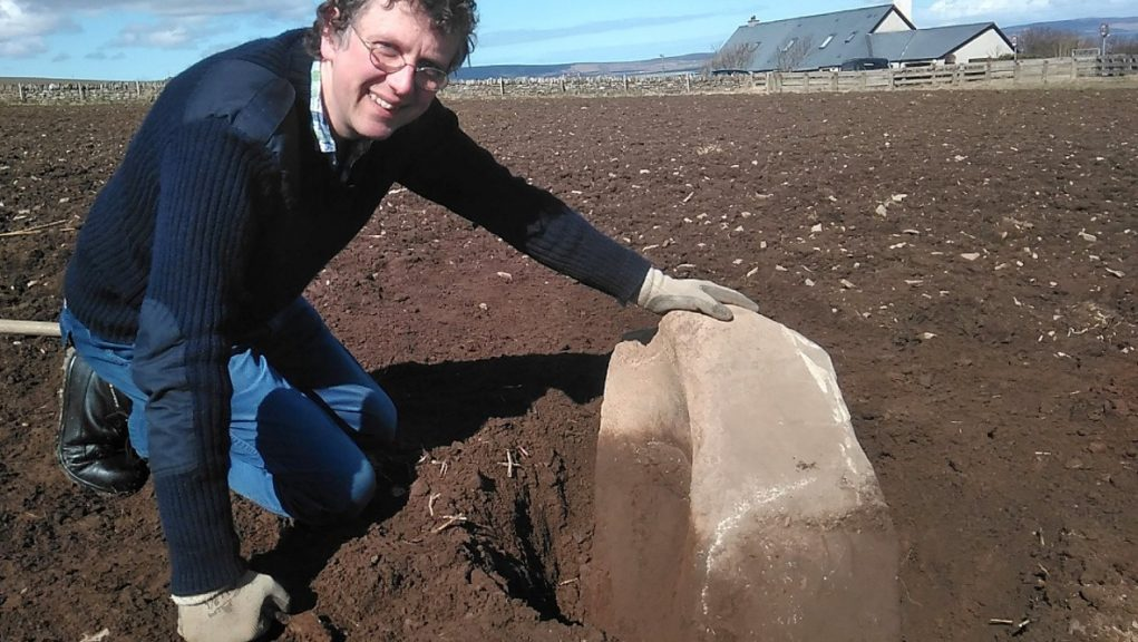 Historic: The 200kg stone was uncovered by Chris Gee.
