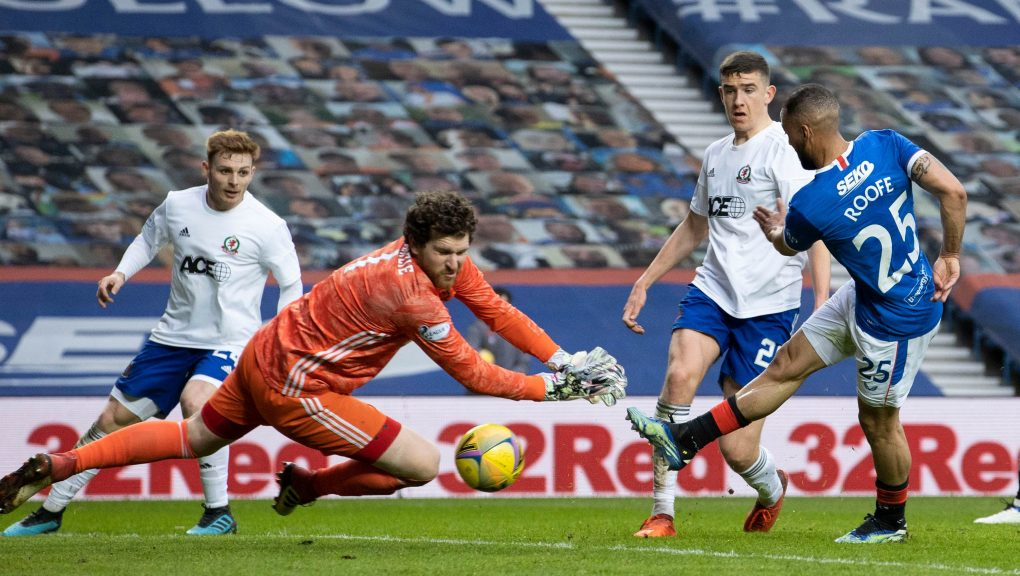 Kemar Roofe scored twice as Rangers cruised to victory.