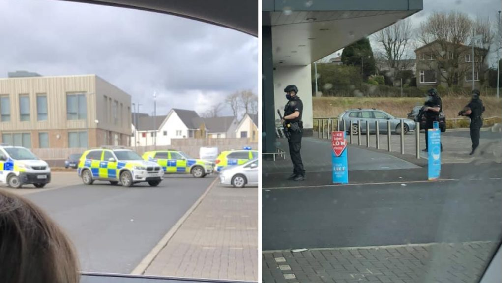 A large number of Police Scotland vehicles and officers are at the Aldi on Greenlaw Way.