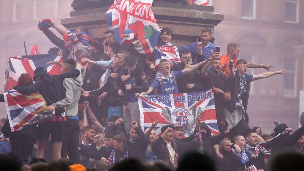 Rangers fans celebrate winning the Scottish Premiership in George Square.