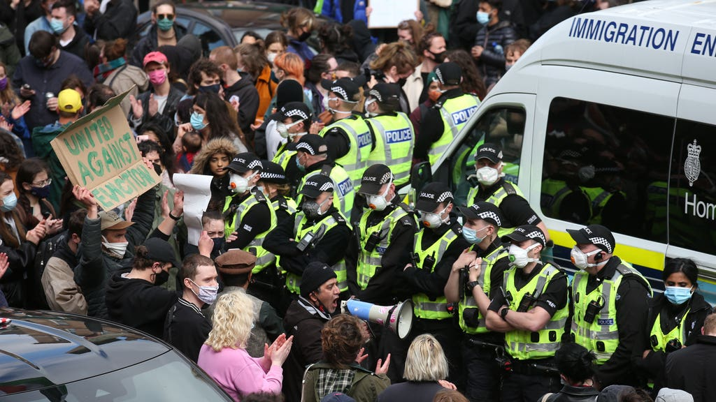 Police and protesters surrounded the immigration van in Kenmure Street, Glasgow, on Thursday.