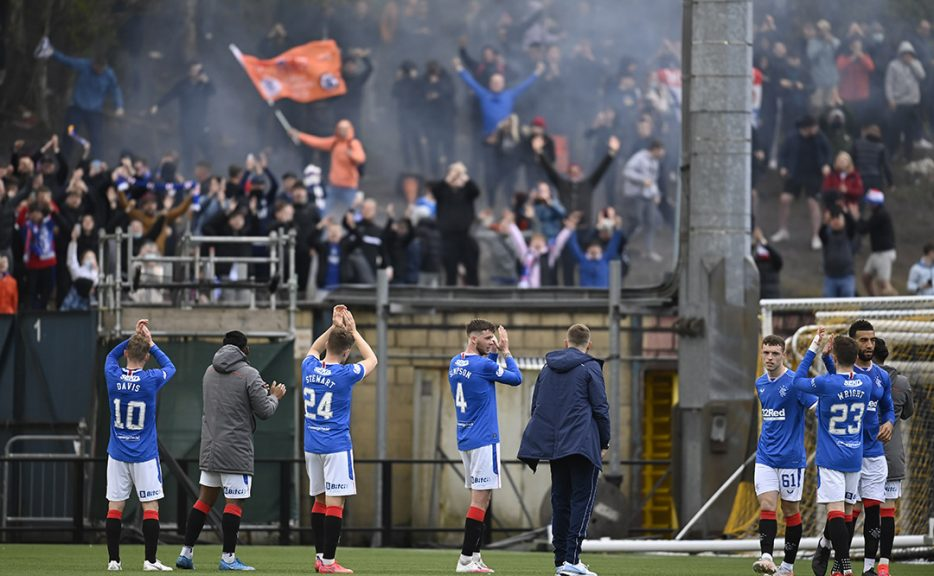 Rangers players and fans celebrate in Livingston on Wednesday night,