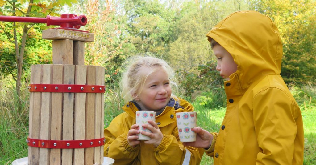 Kids enjoy some freshly pressed apple juice at Little Acorns CIC forest school in South Ayrshire.