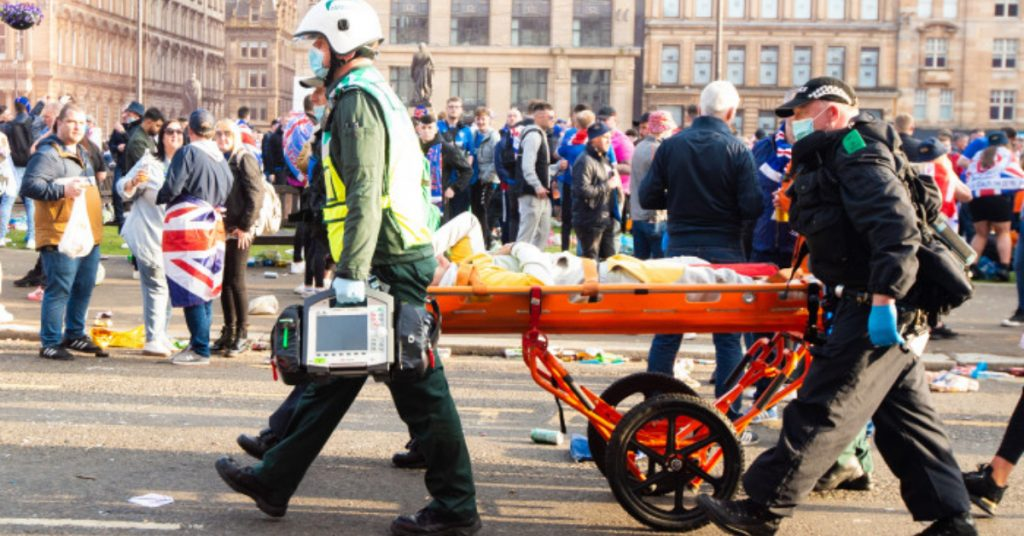 An injured person was stretchered away as Rangers fans celebrated in Glasgow's George square.
