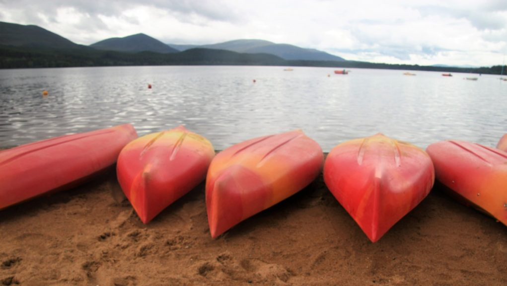 Aviemore: Canoes on the banks of Loch Morlich.
