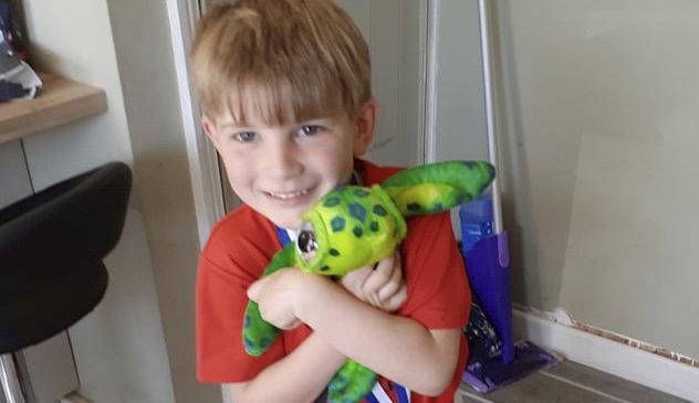 Reunited: Beloved toy turtle 'returned' to heartbroken boy.